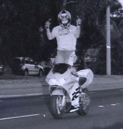 motorcycle rider speed camera flipping bird finger fuck you off